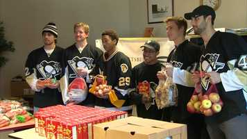 Members of the Pittsburgh Penguins handed out frozen turkeys and vegetables for Thanksgiving dinner to 100 families at the Bedford Hope Center in the Hill District.