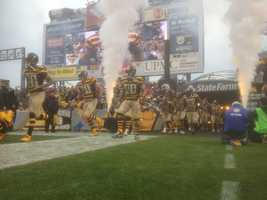 The Steelers take the field against the Detroit Lions wearing their 1934 throwback jerseys.