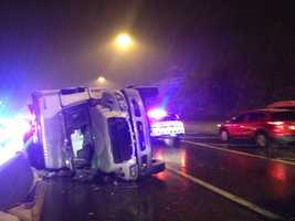 A Brinks security truck overturned on the Parkway West Friday night, spilling coins all over the roadway.
