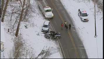 A two-vehicle crash has shut down Riddle Run Road in Springdale Township on Friday afternoon.