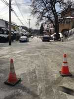 A neighbor reported that there was a water main break on Woodlawn Avenue, and the cars became stuck in the ice that formed.