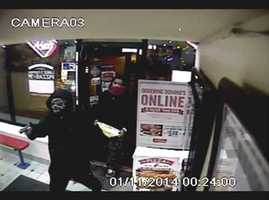 Pittsburgh police have released surveillance video of a robbery at a Domino's Pizza that also left an employee shot in the arm.