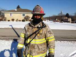 This firefighter's jacket shows the effects of the sub-zero temperatures in Aliquippa.
