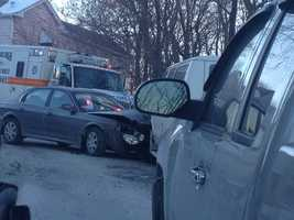 A car and a school van got into a crash on a narrow road in Carrick.