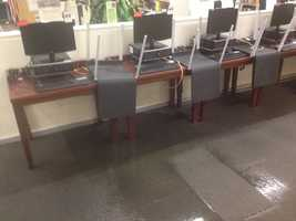 A water main broke Thursday in Downtown Pittsburgh, during the middle of the workday, causing damage at the Carnegie Library branch on Smithfield Street.