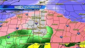 Wednesday 6 a.m. (White represents snow. The deeper the purple, the heavier the snowfall. Pink=ice/sleet/freezing rain. Green=rain. Yellow=heavy rain.)
