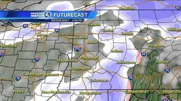 Wednesday 4 p.m. (White represents snow. The deeper the purple, the heavier the snowfall. Pink=ice/sleet/freezing rain. Green=rain. Yellow=heavy rain.)