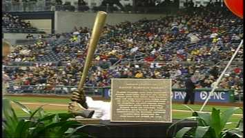 A plaque about Ralph Kiner and a bronze casting of his hands with a bat are on display at the Pirates' ballpark.