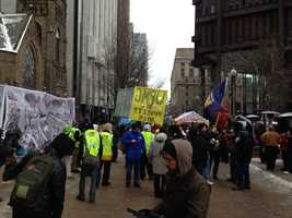 An estimated 300 workers and bused-in labor activists tied up Pittsburgh traffic when they marched downtown to rally outside the corporate offices of UPMC.