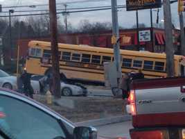 A school bus was struck by a pickup truck Friday morning and ended up on top of a car, killing a person inside the car, Allegheny County police said.