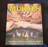"""Philadelphia Murals and the Stories They Tell"" -- inscribed by Jane Golden, founder of the Mural Arts Program in Philadelphia. The book describes the origins of the program as an anti-graffiti effort and its growth into the largest mural program in the nation."