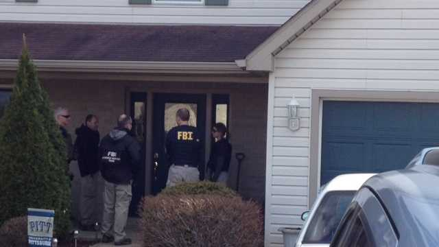 Fbi at suspect house