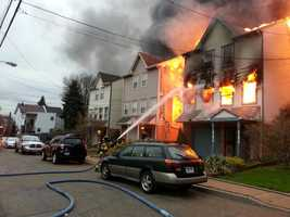 The three-alarm fire on Belleau Street also damaged neighboring homes.