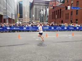Half marathon runners starting to flood the finish line