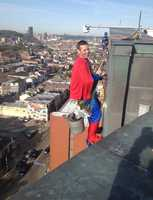 Superman gets ready to wash the hospital windows.