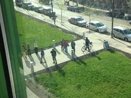 Spectators lined up outside Children's Hospital of Pittsburgh to get a glimpse of the window-washing superheroes.