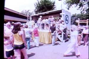 Kennywood Park visitors walk toward the autograph stage on WTAE Day in 1979.
