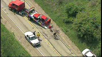 Sky 4 flew over the scene near Park Road in Middlesex Township, where a blue SUV and a red car were being loaded onto flatbed trucks. A silver car with damage to the driver's side was also parked on the side of the road.