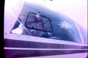 Here's Paul Long in the cockpit of a plane.