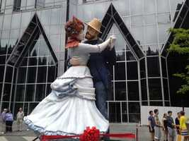 "Seward Johnson's sculpture, ""A Turn of the Century,"" on display at PPG Place."