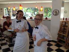 With a classic American diner-style atmosphere, the restaurant chain is known for its selection of burgers and its staff members who sometimes sing and dance.
