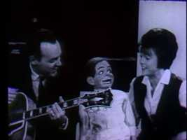 "In this picture, Joe Negri and Sandy Mason sing ""Old MacDonald Had a Farm"" with Tommy the ventriloquist doll."