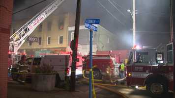 Ambridge firefighters worked through the night to bring the fire under control at a bar on Fourth Street that was formerly owned by Pittsburgh Pirates pitcher Jim Rooker.