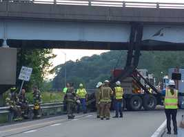 State police said the accident happened while a North Hills Disposal rollback truck had the frame to the rollback fully elevated, for reasons not yet known. PennDOT is inspecting the overpass for damage.