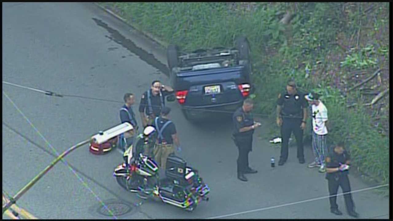 img-Car overturns on Woodruff Street on Mt Washington