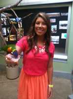 Social Media Producer Amanda Jupena feeding the Lorikeets a cup of nectar!