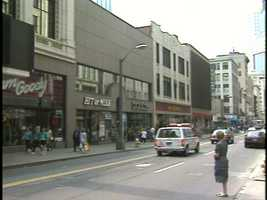As you continued down the block, heading toward Wood Street, you would pass a Sam Goody music store, a Hit Or Miss women's clothing store and a McCrory's department store.