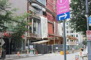 The rest of the stores toward the end of the block have been torn down to make way for construction of a PNC skyscraper.