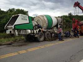 A cement mixer went off Route 228 and down an embankment after crashing into an oncoming tri-axle truck Tuesday in Middlesex Township, Butler County.