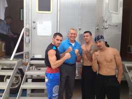 Mike receives some boxing tips from (left to right) Dave Buglione, Mark Shrader and Jose Caraballo.