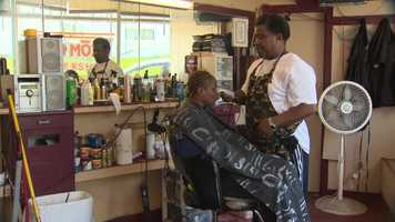 """Master Peewee at Team Mozzi Barber Shop just wants to know one thing: """"Are we going to benefit from it? Because all we want is good jobs."""""""