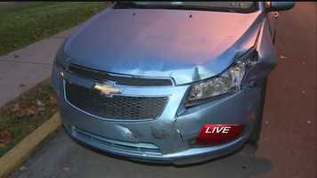 This is one of the parked cars that was damaged in the crash. Click here to watch the report.