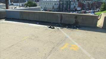 Debris, broken lights and shattered glass were scattered along the Birmingham Bridge after the fatal crash.
