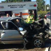 A three-vehicle crash caused injuries on William Penn Highway in Murrysville, near the border with Monroeville.