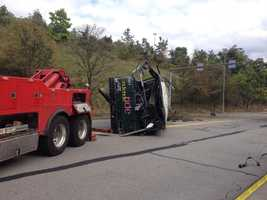 A tow truck slowly pulled the Port Authority bus that rolled downhill off Interstate 279.