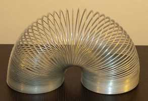 James was inspired when he saw the springs reaction to the ground and he came up with the idea for the Slinky toy. The first slinky was sold at Gimbel's Department Store in Philadelphia in 1945 at the start of the Christmas season.(Source: inventors.about.com)