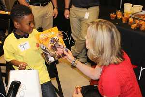 He's so excited to show Sally Wiggin his Steelers autographs!