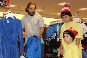 Ross Ventrone helping his shopping buddy pick out a blue coat