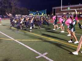Seton-La Salle High School football players run onto the field.