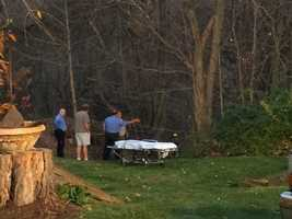 Emergency responders waited with a stretcher at the top of the hill to take the man to a medical helicopter.