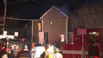 A man died in a house fire in Versailles that also injured a firefighter and another person.
