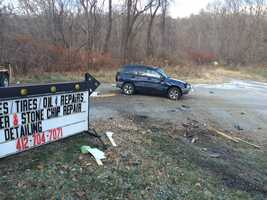 A body was found near a car that crashed on the property of an automotive business in Plum.