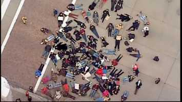 """An overhead look at the """"die-in,"""" as people lie down on Liberty Avenue to protest the decision not to indict a police officer in the death of Eric Garner."""