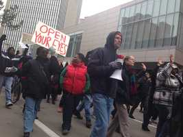 People march down Liberty Avenue to protest the decision not to indict a police officer in the death of Eric Garner.