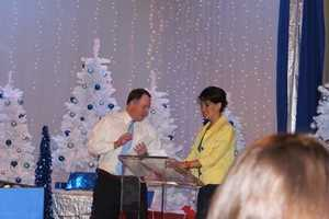 Anchor Wendy Bell and WTAE President and General Manager Charles W. Wolfertz III hosting WTAE's annual Christmas party