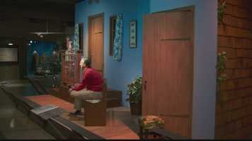 """A lifelike figure of Fred Rogers wearing his signature red sweater, khakis and sneakers on the """"Mister Rogers' Neighborhood"""" show."""
